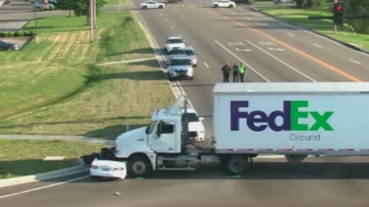 FedEx semi collides with car, driver airlifted to hospital