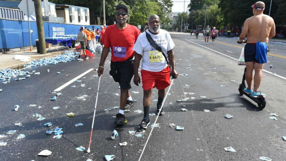 Blindness doesn't deter brothers from completing 10K road race