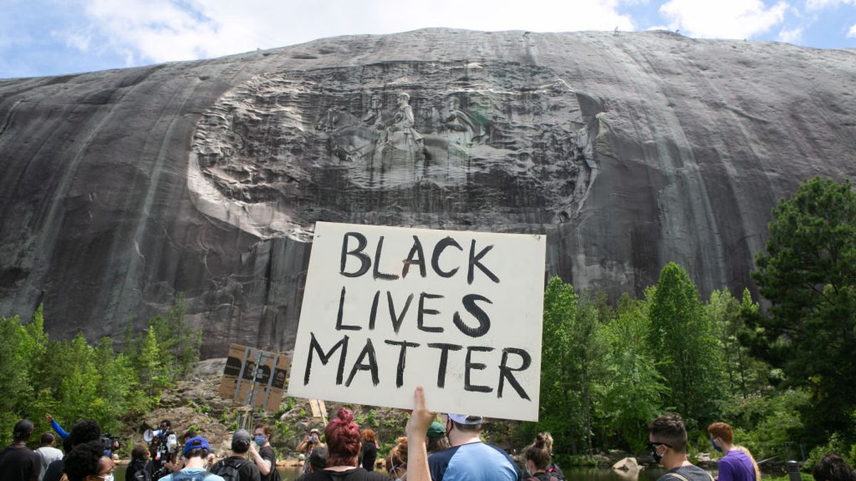 Demonstrators march at Stone Mountain demanding removal of ...Stone Mountain